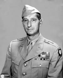 General Clark with tan uniform and garrison cap