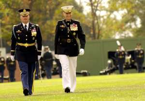 Marine General on right, Army officer on left in traditional uniforms