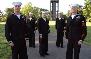 Navy sailors with service stripes. The Navy and Marine corps wear 1 stripe for every 4 years of service.