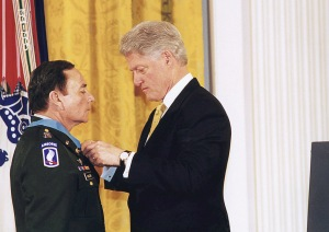 "President Clinton MOH recipient Rascon wearing the 173rd Airborne Brigade ""combat patch"""