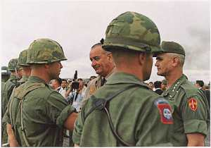 In the early days of Vietnam a color combat patch was worn instead of the black and green patch adopted in the 1970s to go with the field uniform